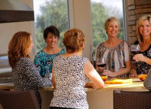 Julie Held entertains some friends on the lanai.