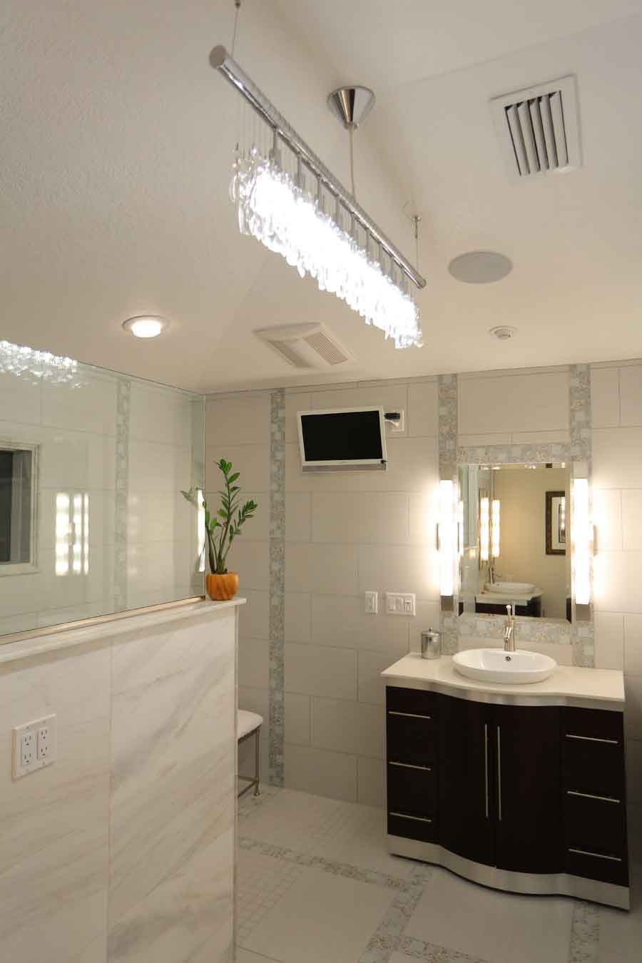 The master bathroom underwent a major renovation. The old shower was converted into a glass medicine cabinet and linen closet. The new shower is equipped with wonderful amenities, including rain showerheads, body jets, a television, and stereo.