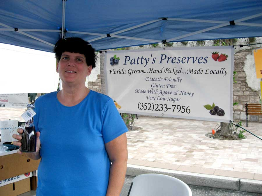 Quick-Bites---Patty-Grantham-shows-off-some-of-her-homemade-blueberry-sauce-at-Spanish-Springs-Farmers-Market.