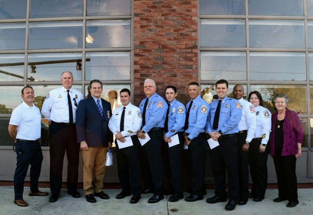 clermont-fire-department-members-city-officials-pose-fire-station