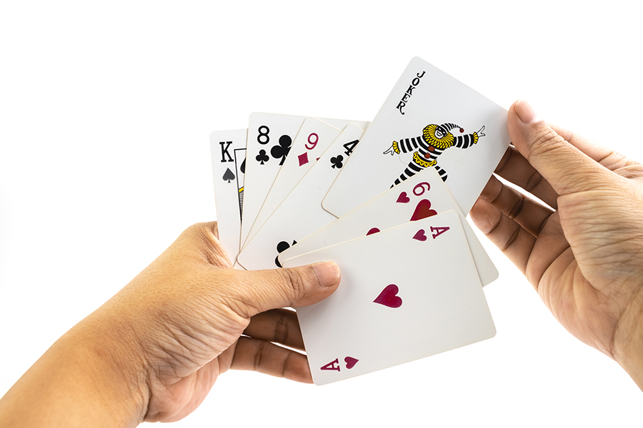 Joker-card-in-the-hand-of-man