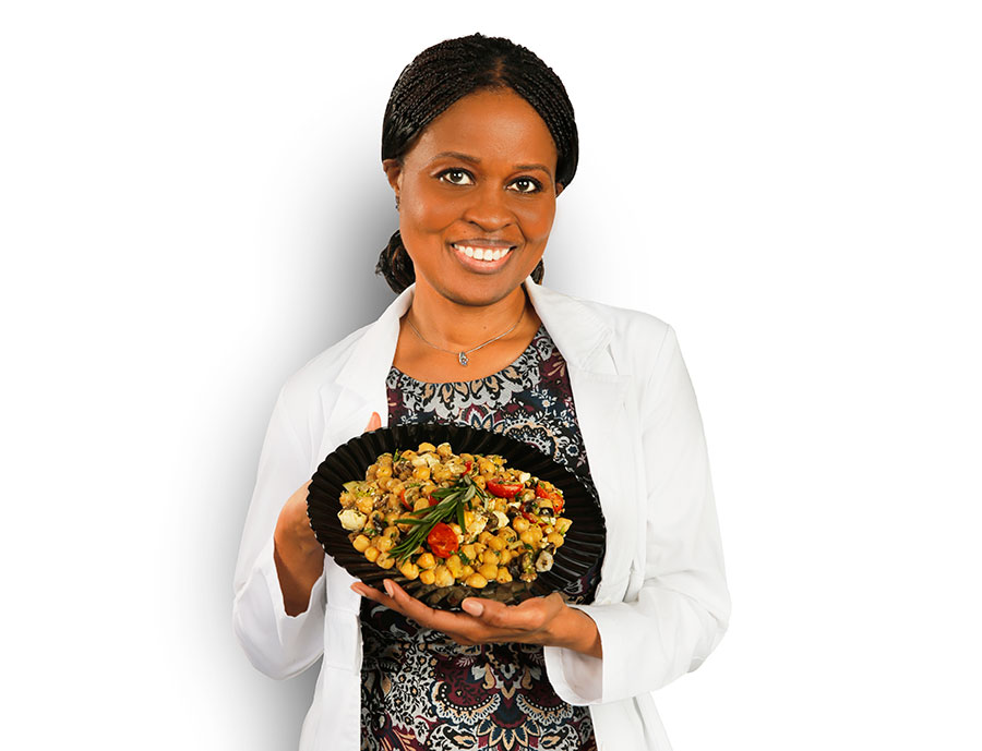 woman-holding-food-on-black-dish