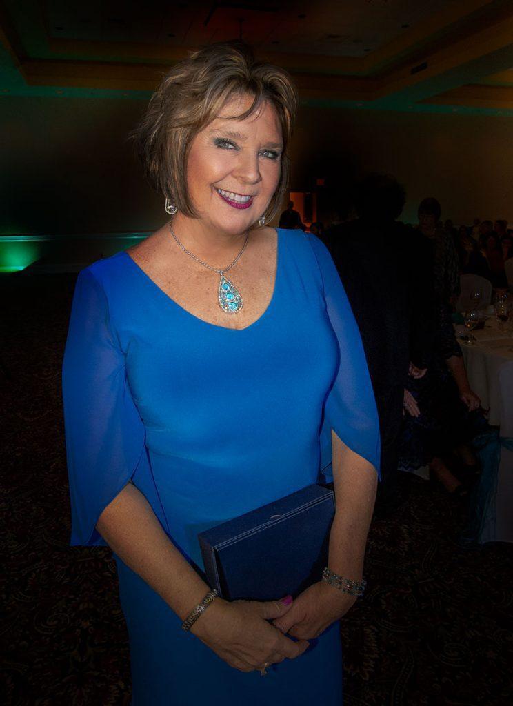 woman-posing-wearing-blue-dress