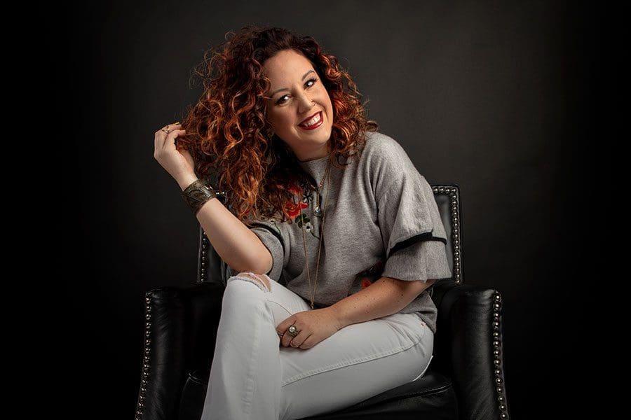 Danielle-Daugherty-sitting-on-black-seat