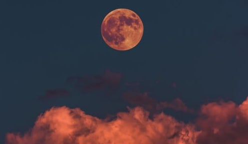 orange-moon-above-clouds